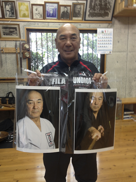 Tokumura shows off the new pictures for his dojo.