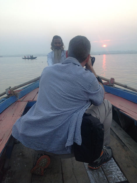 Chris Willson photographing the boatman on the Ganges  - image by Kim Logue
