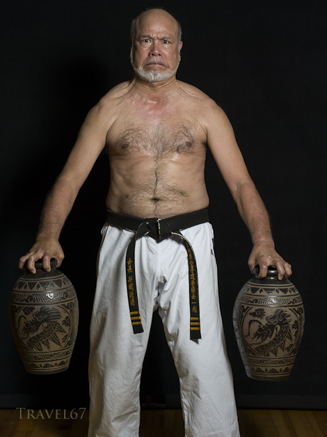 Kiyohide Shinjo training with  awamori jugs.