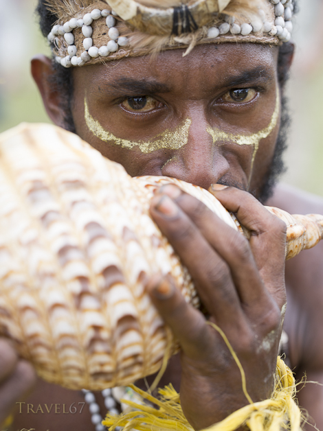 Man from Buim Akwa tribe with Conch shell horn, Goroka Show, Papua New Guinea