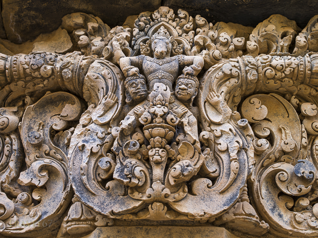 Ornate carvings in the sandstone lintels above doorways at Banteay Srei a Hindu Temple dedicated to Shiva. Siem Reap, Cambodia
