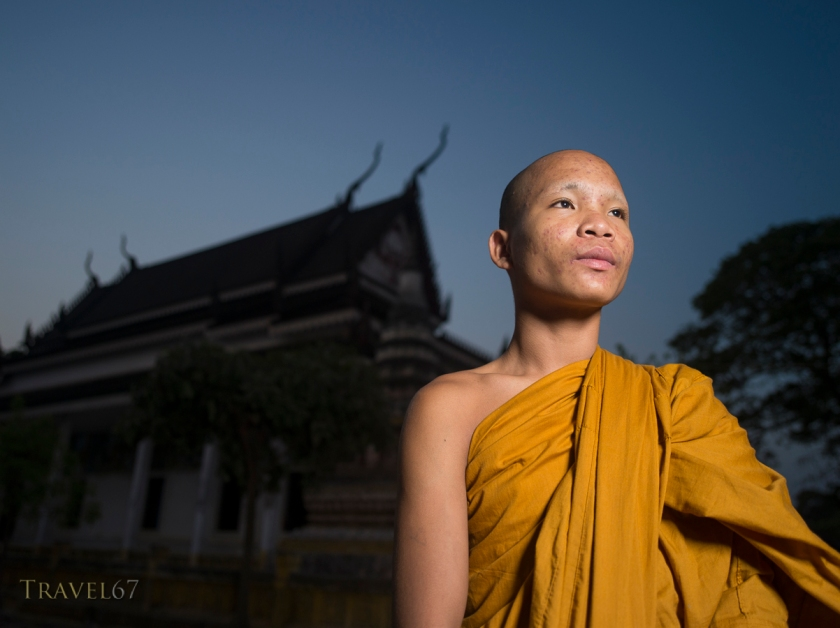 Young monk at dawn, Angkor Wat, Cambodia