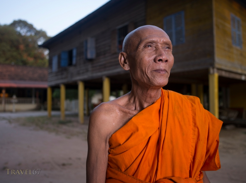 Elderly monk at dawn, Angkor Wat, Cambodia