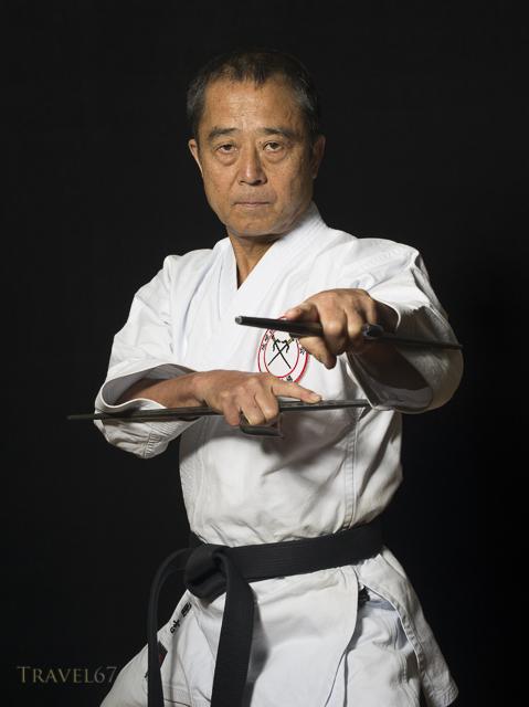 Yukio Kuniyoshi. Kaicho of Ryukyu Kobudo Hozon Shinko Kai. Training on Okinawa, Japan with manji sai