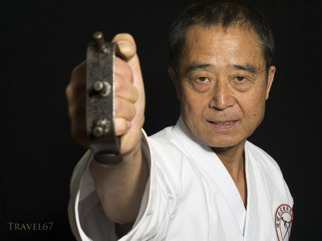 Yukio Kuniyoshi. Kaicho of Ryukyu Kobudo Hozon Shinko Kai. Training on Okinawa, Japan with tekko ( knuckledusters ).