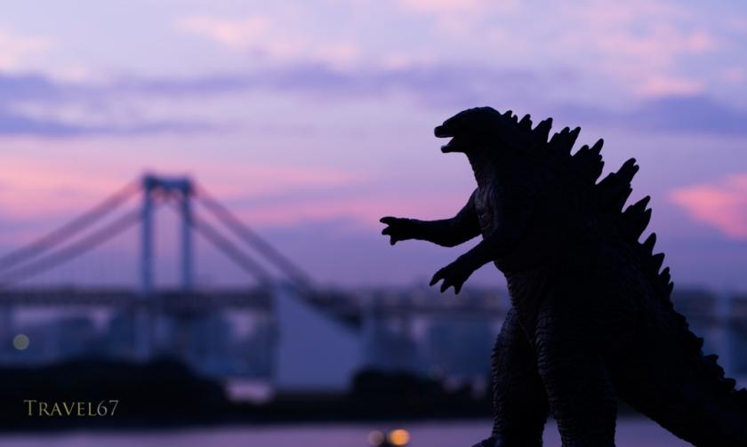 Godzilla ( toy )  looms over the Tokyo Bay, Odaiba, Tokyo, JAPAN.