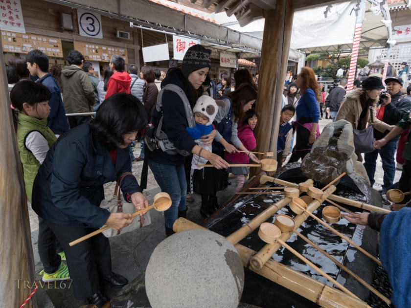New Year Celebrations at Futenma Shrine, Okinawa, Japan. 1/1/2015 - Purifying hands at the entrance to the shrine.
