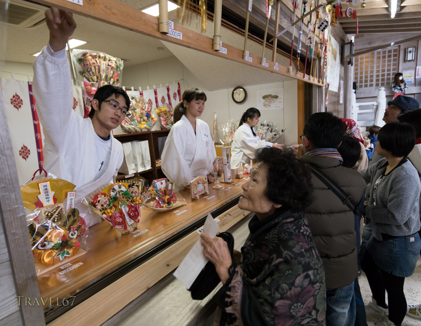 New Year Celebrations at Futenma Shrine, Okinawa, Japan. 1/1/2015. Purchasing omamori charms for the year.
