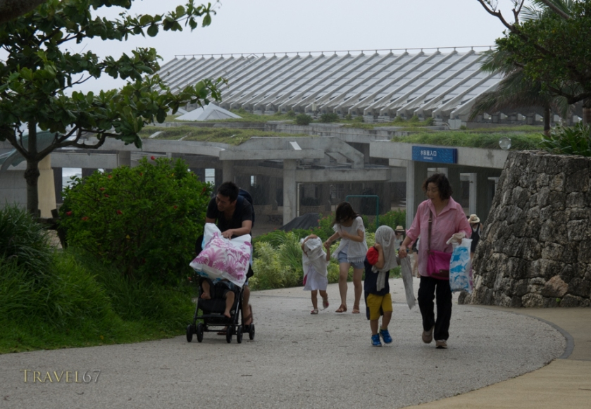Visitors to the Churaumi Aquarium hit by downpour. Typhoon Chan-hom brings strong wind and rain to the islands of Okinawa, Japan  9 July 2015