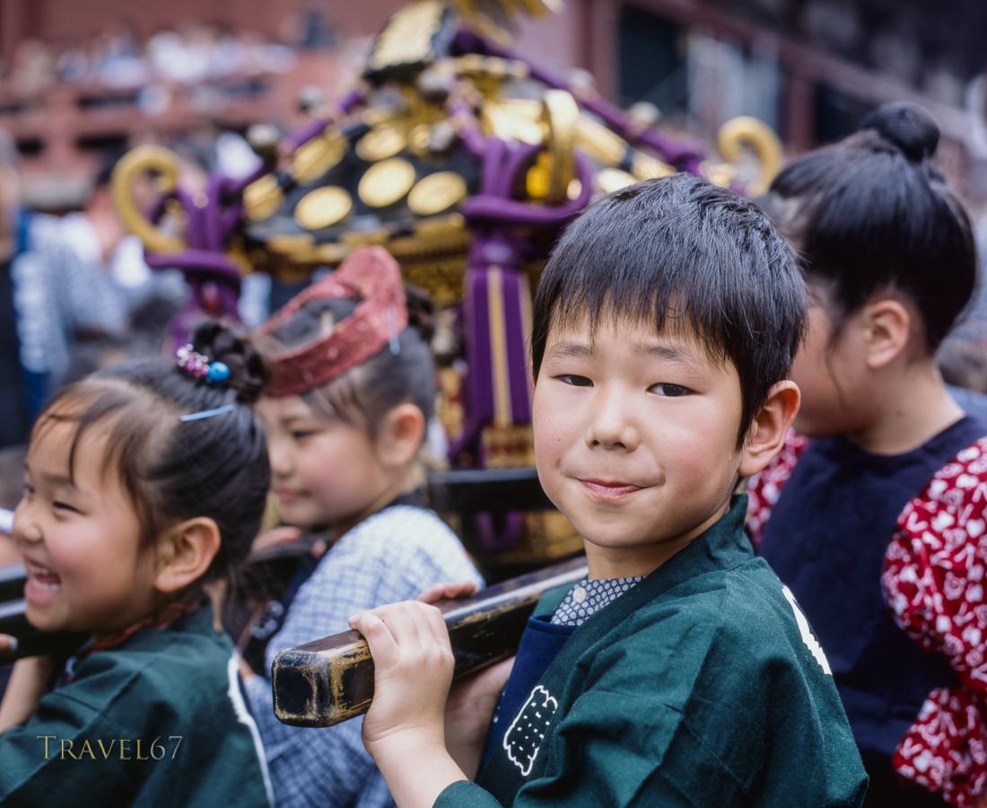 Sanja Matsuri, Asakusa, Tokyo.  Small mikoshi for small children. The whole family takes part in the celebration.