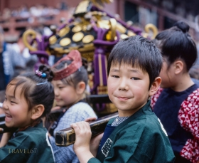 Sanja Matsuri, Asakusa, Tokyo. Small mikoshi for small children. The whole family takes part in the celebration.