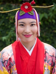 Okinawan woman dressed in traditional Bingata Kimono at Shuri Castle, Okinawa, Japan
