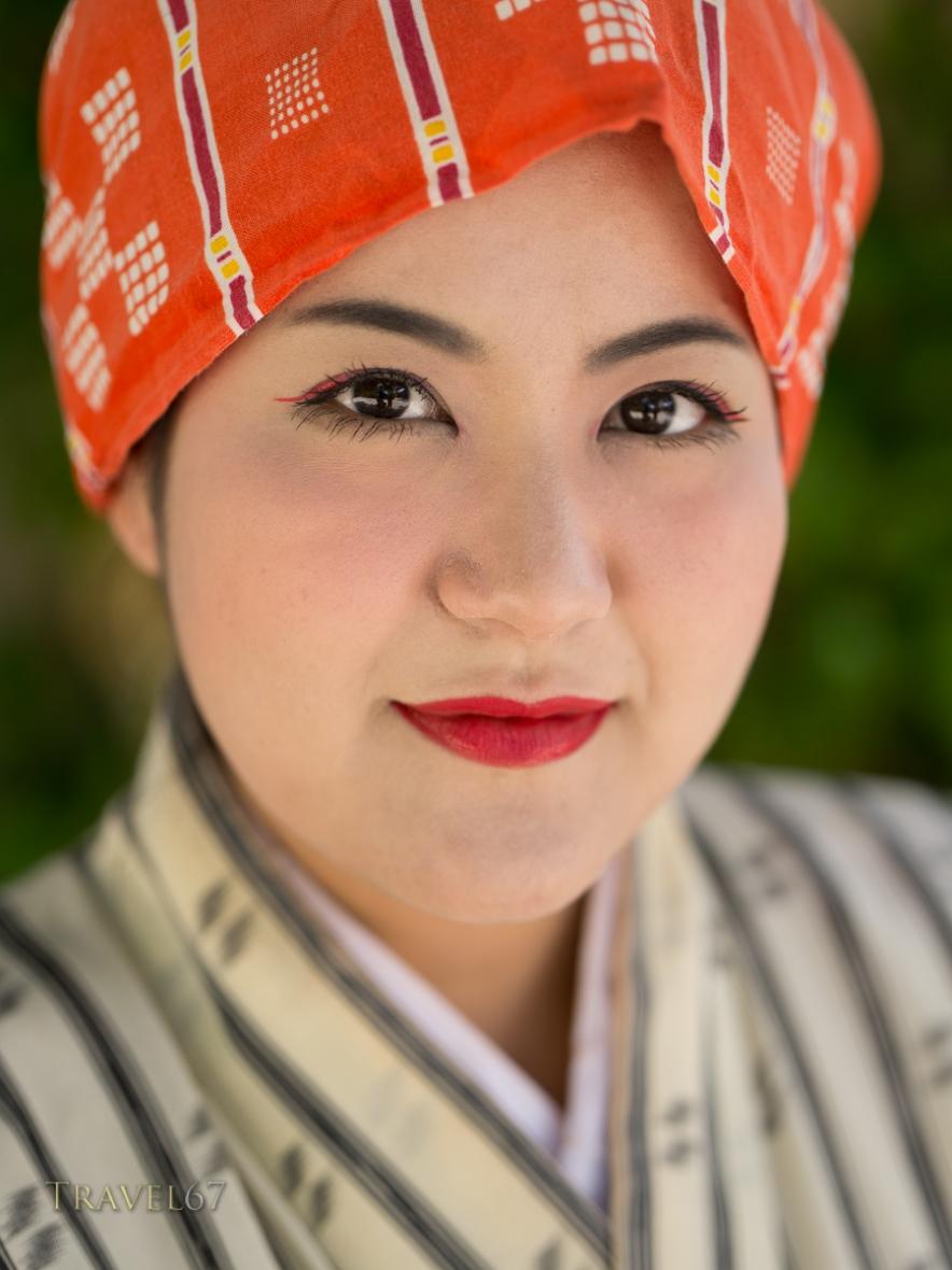 Okinawan woman in traditional dress.