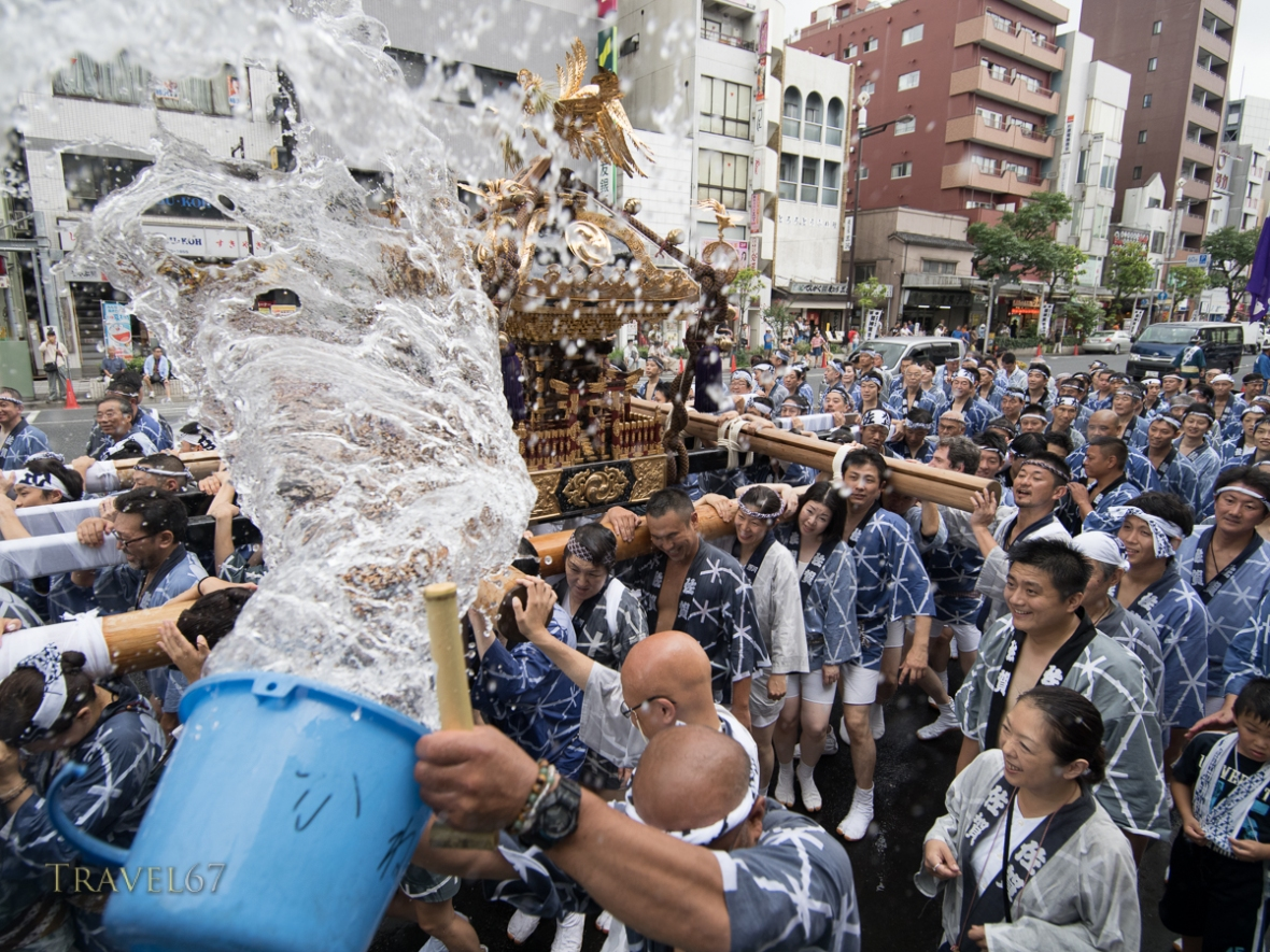 Fukagawa Fetival aka water throwing festival held at Tomioka Hachimangu Shrine, Tokyo, Japan on Sunday Aug 16, 2014. Water thrown at mikoshi (portable shirines) carried through streets in one of the great Shinto festivals of Tokyo.
