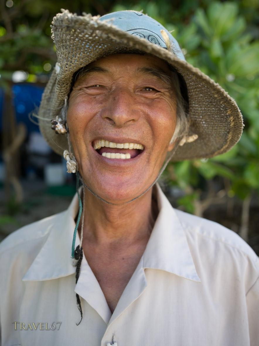 Okinawan man at Yoshino Beach - Miyako Island, Okinawa, Japan