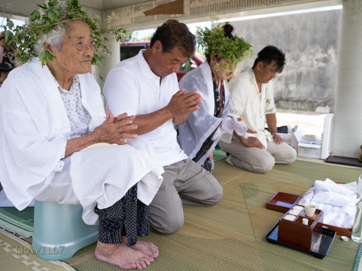 96 year old Kaneshi Fusae wearing wreath of ryukyu botanzuru at Unjami Festival on Kouri Island, Okinawa