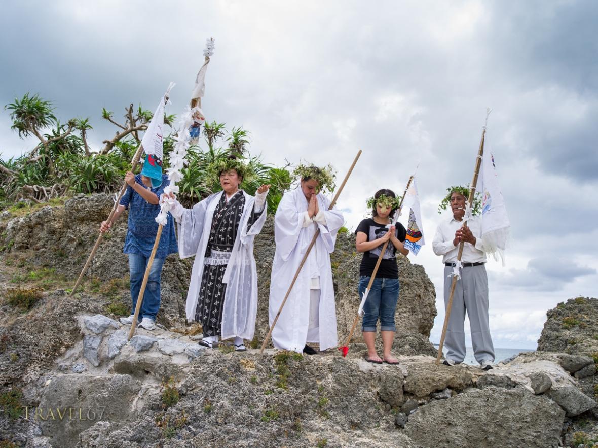 Toguchi Ayako (79) leads prayers at Unjami Festival on Kouri Island, Okinawa