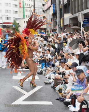 Dancing in the streets at the 33rd Asakusa Samba Festival in Tokyo, Japan. Sat. 14 August 2014. 22 teams including local Japanese and Brazilians bring Samba to the roads around Asakusa Shrine. Watched by around 500,000 spectators.