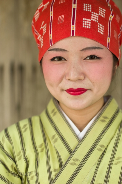 Young okinawan woman in traditional yukata at at Ryukyu Mura, Yomitan Village, Okinawa, Japan