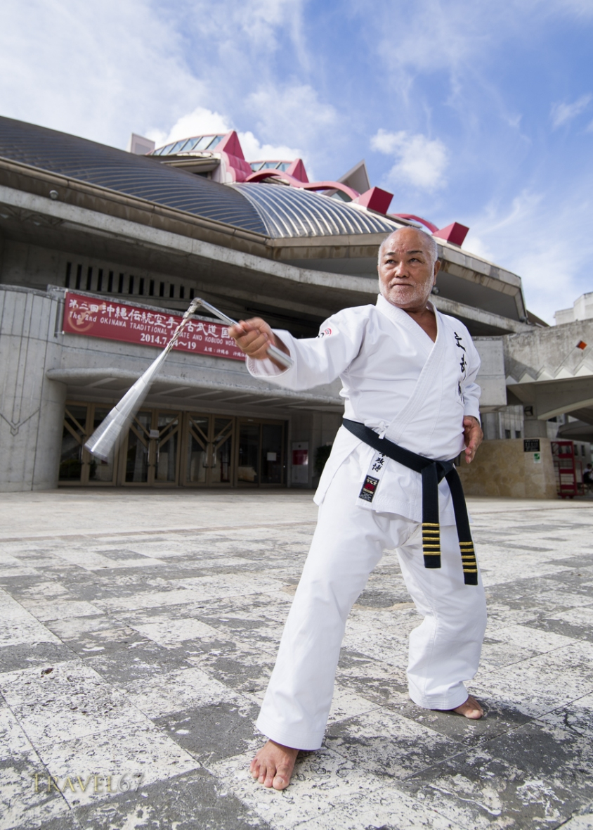 Masahiro Nakamoto - Hanshi 10th dan, Okinawa Dentou Kobudo outside the Budokan, Naha City, Okinawa