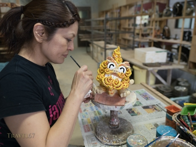 Naoko Yamashiro creating ceramic shisa at Yachimun no Sato ( Pottery / Artists Village ) in Yomitan, Okinawa, Japan